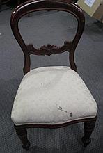 A pair of Victorian style balloon back chairs