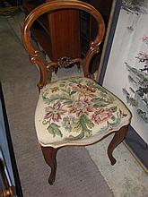 A Victorian balloon back chair with tapestry cover