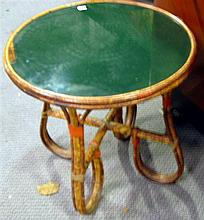 A vintage cane side table with class top