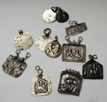 Eleven Indian Silver Pendants with Animals and Figures, 19th/20th Century,