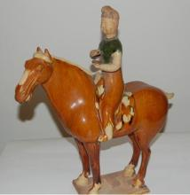 A Sancai-Glazed Pottery Figure of a Horse and Male Rider, Tang Dynasty, 618-907