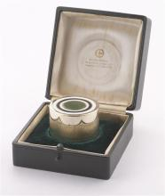A Gerald Benney cased sterling silver and enamel circular form box, with textured finish