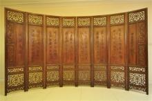 A Carved Chinese Rosewood Eight Panel Screen, Qing Dynasty, 19th century