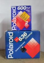 A boxed 636 Close-Up Polaroid camera with 600+ film