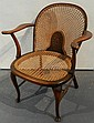 A Regency style cane seat oak armchair, Grace Brothers Ltd sticker and impressed makers mark HGM with two arrows