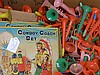 A box of assorted new old stock children's toys