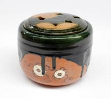 A Japanese studio pottery Hibachi with an Oribe palette,
