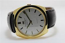 A Gentleman's 18ct Yellow Gold IWC and Tiffany & Co Wrist Watch