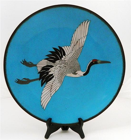 A Japanese Cloisonne Blue Dish with a flying red crested crane in the  centre . Taisho Period 20th century.