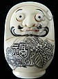 A Japanese Ivory Dharma Novelty Netsuke with popping eyes, carved from a solid oval piece of tusk.