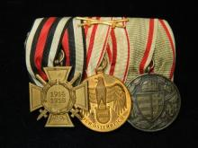A WWI medal bar consisting of Combatants cross of honor 1914-1918 Austrian long service and Hungarian combination commemorative serv...