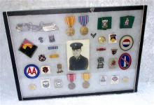Cased Grouping Of US Military Items Including Dog Tags, Medals, Enamel Regimental Badges, Embroidered Cloth Patches And Medal Bars