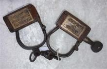"""Unique Pair Of Cast Iron Woman And Child Handcuffs, Brass Plaque Marked """"Negro Woman Or Child Only"""" """"Property Of Georgetown County P..."""