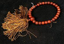Late meiji period wood prayer beads with gold thread tassel