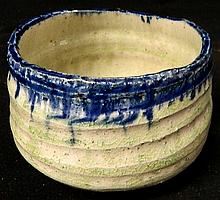 A Celadon glaze pottery bowl with blue drip glaze rim