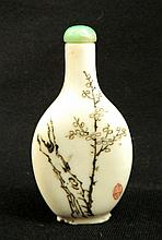 A Chinese porcelain snuff bottle with cherry blossoms
