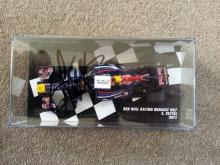 2011 GP 1/43 Red Bull model signed in person by Vettel and a 2011 GP Vodaphone Mercedes model 1/43 signed in person by Hamilton.