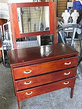 A vintage three drawer dressing table
