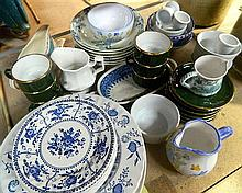 A quantity of contemporary ceramics including plates, cups, bowls etc