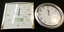 2 quartz wall clocks