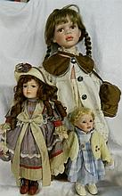 Three vintage porcelain dolls