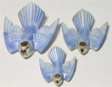 A Graduated Set of Three Poole Porcelain Blue Birds,