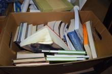 A carton of assorted books and novels, mostly new