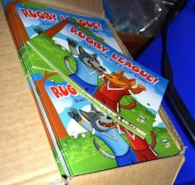 A box of rugby league childrens books