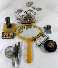 An eclectic mix of odds and ends, including fountain pens, amethyst specimen tree, Nefertiti bronze
