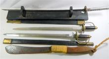 A reproduction Japanese samurai sword on stand, together with two other reproduction swords and scabbards, and a machete