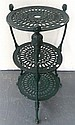 A three tier painted iron plant stand