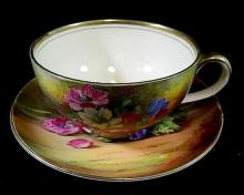 A signed hand painted Royal Winton oversized 'Anemone' breakfast cup with saucer