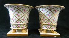 A pair of signed Regency-style Herend spill vases