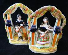 A pair of Staffordshire flatback figures