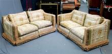 A matching pair of twin seater sofas