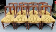 A set of eight stylish walnut dining chairs