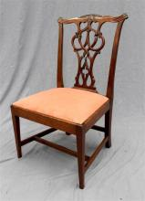A late 19th Century nursing chair in the Chippendale style