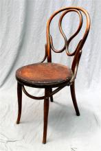 A single Austrian bentwood chair with a leather seat insert