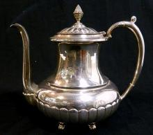 A Mexican sterling silver teapot