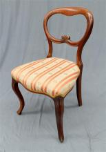 A mid Victorian Mahogany balloon back chair with cabriole legs
