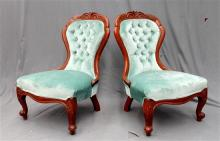 A pair of pale green velvet upholstered Grandmother Chairs