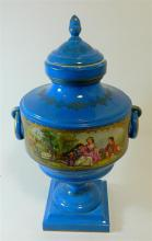 A Sevres porcelain urn with hand painted centre panel of a courting couple