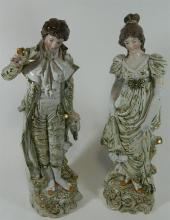 A pair of Continental male and female porcelain figures