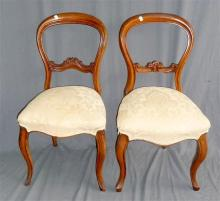 Two similar Victorian balloon back chairs with cabriole legs