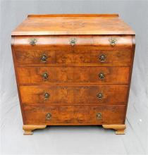 A 1930s burr walnut chest of seven drawers in the Chippendale style