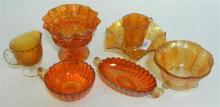 A collection of seven pieces of Carnival glass