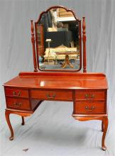 A Queen Anne style dressing table with adjustable mirror