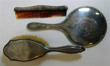 A three-piece sterling silver backed brush, comb and mirror set, Birmingham