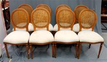 A set of eight balloon back style dining chairs with rattan backs