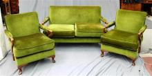 A 1960s three piece lounge suite in the classic Danish style including a two seater and two armchairs